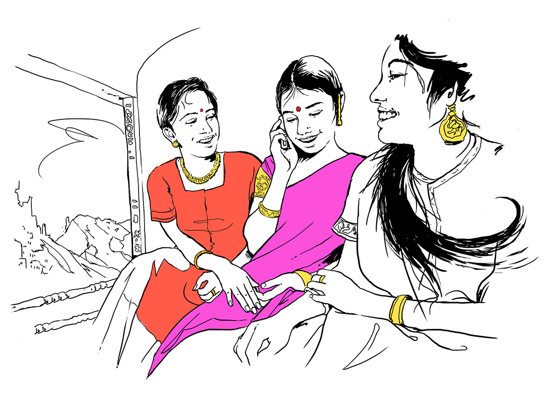 Jeunes filles en Inde au téléphone